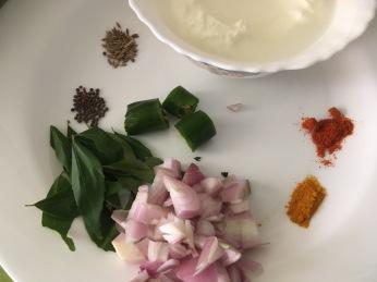 Shallots, Curry leaves, Green Chillies, turmoeric, Chilli powder, Cumin and mustard
