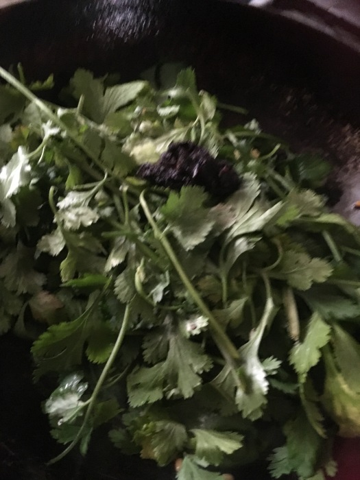 Add 1 tsp oil add the coriander and the tamarind and saute till the leaves wilt